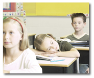 Two pictures of the same young student. In one she is sleeping at her desk while other students are attentive to the front of the class. In the second, she is focused entirely on the front of the class and has her hand energetically raised high while other students are not focused on the front of the classroom.