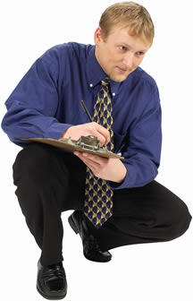 A picture of an educator who is writing on a clipboard